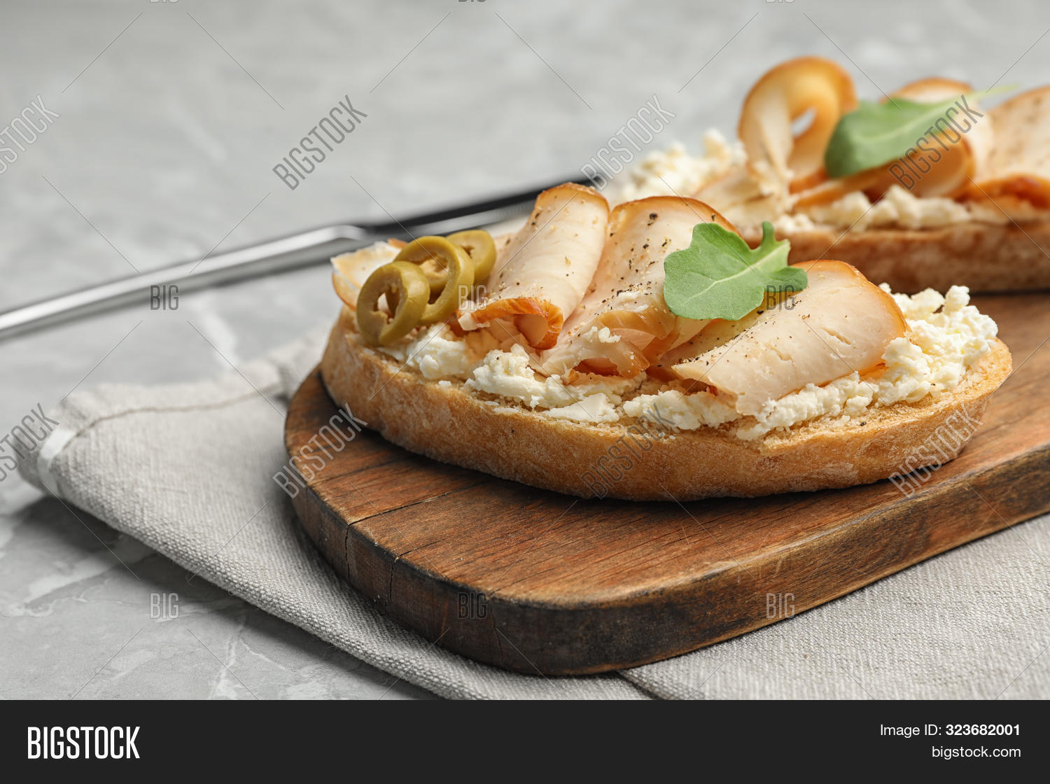Board With Delicious Chicken Bruschettas On Grey Marble Table