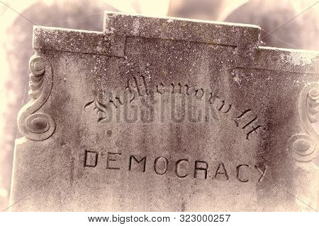 In Memory of democracy. Brexit referendum and election concept image. Gravestone with the word democracy. Political madness and modern politics gone bad. poster
