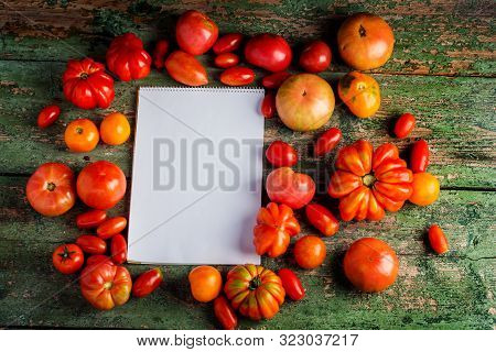 Flat-lay Of Fresh Colorful Ripe Fall Or Summer Heirloom Tomatoes Variety Over Rustic Background With