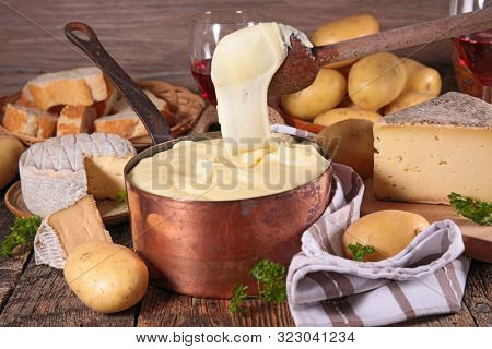 aligot, french gastronomy with cheese, potato and sausage