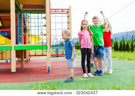 Friends At Afterschool Summer Camp Playing Outdoor