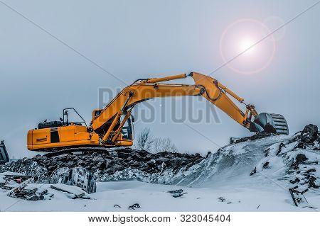 Excavator Is Loading Excavation To The Truck. Excavators Are Heavy Construction Equipment Consisting