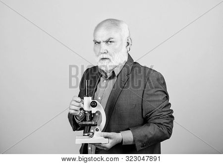 Molecular Biology Phd Projects. Mature Man Formal Suit With Microscope. Professor University Lecture