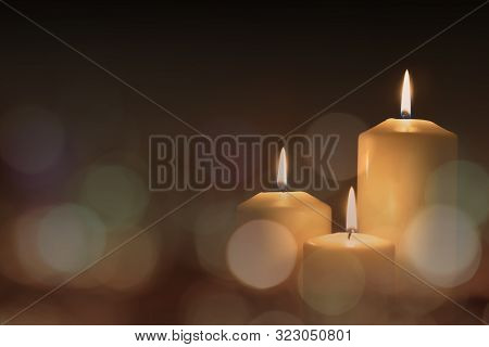 Christmas Advent Candle Light In Church With Blurry Golden Bokeh For Religious Ritual Or Spiritual Z