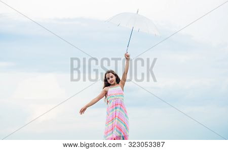 Fly drop parachute. Dreaming about first flight. Kid pretending fly. Happy childhood. I believe i can fly. Touch sky. Fairy tale character. Feeling light. Girl with light umbrella. Anti gravitation poster