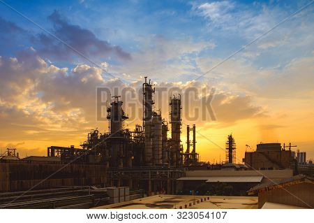 Oil And Gas Refinery Plant Or Petrochemical Industry On Sky Sunset Background, Factory At Evening, M