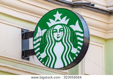 Moscow, Russia - September 13, 2019: Starbucks Round Sign Installed On The Wall Of Old Building In C