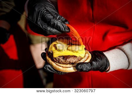 Chef Makes A Burger In Black Gloves.