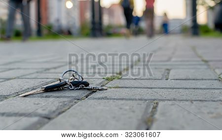 The Lost Bunch Of Keys, Lies On The Asphalted Sidewalk Of A Footpath In The Avenue Of City Park