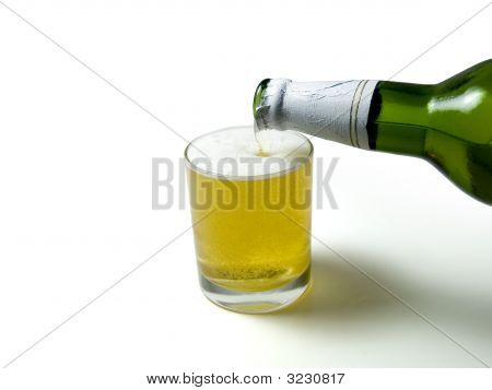 Beer Pouring Down From A Bottle