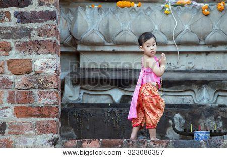 Ayutthaya, Thailand - July 16,2019: People celebrating Visakha Bucha Day at at Wat Yai Chaimongkol Buddhist temple.