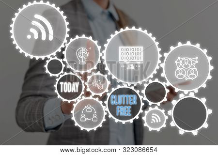 Writing note showing Clutter Free. Business photo showcasing Well organized and arranged Tidy All things in right places Woman wear formal work suit presenting presentation using smart device. poster