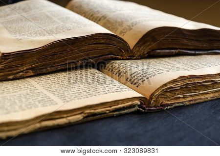 Jewish Bible. An Open Old Jewish Books. Opened Scripture Pages. Selective Focus. Closeup Of Hebrew T