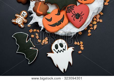 The Hand-made Eatable Gingerbread Halloween Pumpkin, Ghosts, Bat And Sceletons On Black Background