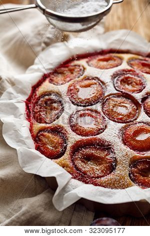 Plum Cake, Traditional Homemade  Cake With Sweet Plums, Sprinkled With Powdered Sugar, Close-up. Fru