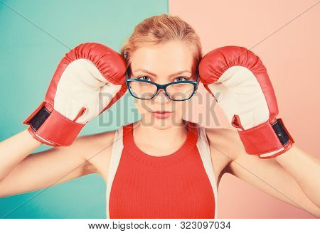 Smart And Strong. Woman Boxing Gloves Adjust Eyeglasses. Win With Strength Or Intellect. Strong Inte