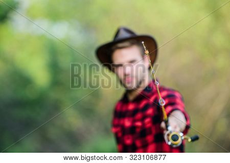 Hook And Bait. Fishing Hobby. Guy In Cowboy Hat Fishing Equipment Nature Background Defocused. Hipst