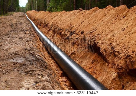 Natural Gas Pipeline Construction Work. A Dug Trench In The Ground For The Installation And Installa