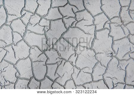 Close-up Texture Of Old Cracked White Paint On The Iron Surface.