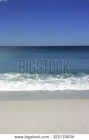 Seascape In Blue With Breakers As Background.