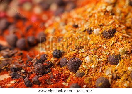 Closeup of spices composition anise cinnamon paprica curry pepper