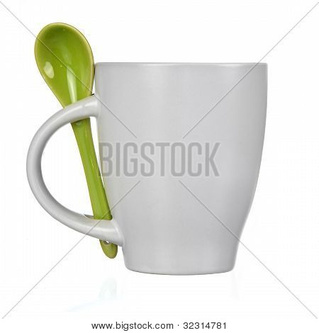 White Cup With Spoon Isolated On White