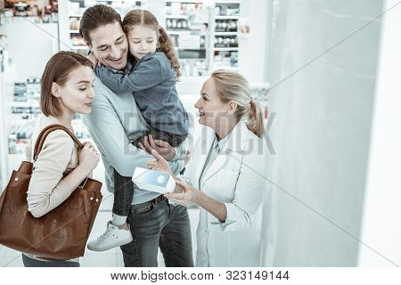 A Druggist Consulting The Spouses And Their Daughter