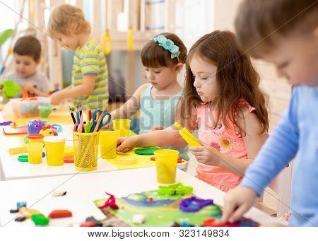 Art And Craft Activity In Kindergarten. Preschool Kids Hands Working In Day Care Center. Group Of Ch