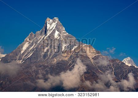 Fishtail peak or Machapuchare mountain with clear blue sky background at Nepal. poster