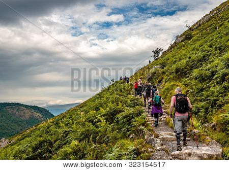 Ben Nevis / UK - August 24 2019: People hike on Mountain Path, the most popular route up Ben Nevis, in the Scottish Highlands.
