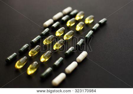 Omega 3, Spirulina, Chlorophyll,magnesium Capsules On Black Dark Background. Dietary Supplements. He