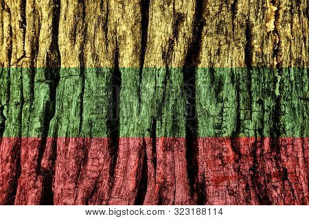 Lithuania Flag Painted On Old Decrepit Wooden Surface. Textured Creative Background For Design.
