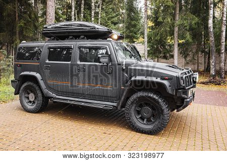 Saint-petersburg, Russia - October 8, 2017: Black Hummer H2 Car Stands On A Parking Lot, Side View