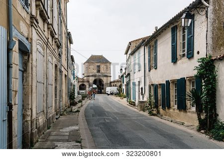Saint Martin De Re, France - August 7, 2018: Street With Traditional Old Houses In Saint Martin De R