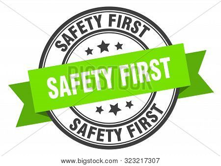 Safety First Label. Safety First Green Band Sign. Safety First