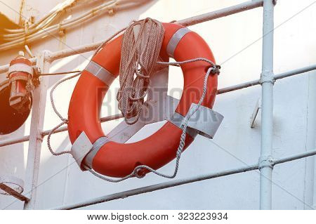 Lifebuoy On Handrails Of Frigate Or Warship. Rope Wound On Handrails With Lifesaver.