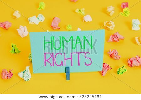 Writing note showing Huanalysis Rights. Business photo showcasing Moral Principles Standards Norms of a showing protected by Law Colored crumpled paper empty reminder white floor clothespin. poster