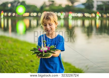 Boy Tourist Holds The Loy Krathong In Her Hands And Is About To Launch It Into The Water. Loy Kratho