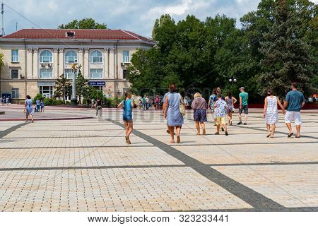 Kerch, Russia - 5 August 2019: People Walk Next On Lenina Square In Kerch