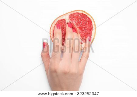 Young Woman Touching Half Of Grapefruit On White Background, Top View. Sex Concept