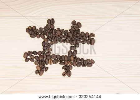 Hashtag. A Hashtag Sign That Is Depicted From Roasted Coffee Beans. Coffee Beans Lie In The Form Of