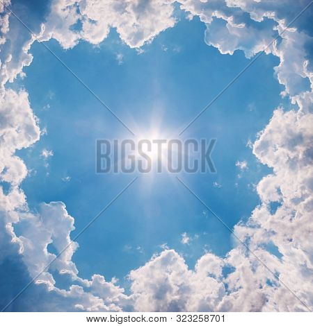 Blue Sky With White Clouds And Sun. The Natural  Background