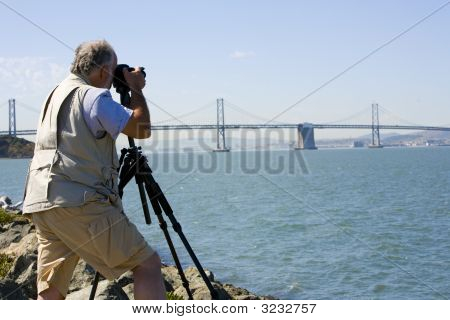 Photographer Focusing His Camera