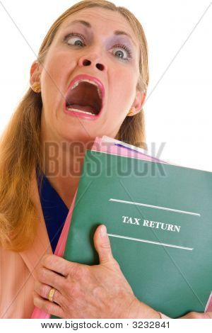 Frustrated Business Woman Doing Taxes