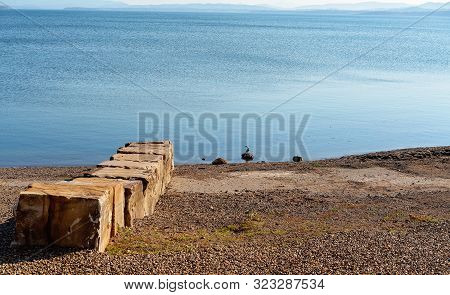 Remaining Rocks From An Old Jetty On A Dam With Receding Water Levels