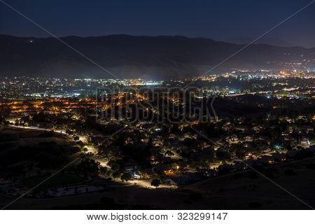 Night hilltop view of suburban Simi Valley homes and streets near Los Angeles in Ventura County, California.