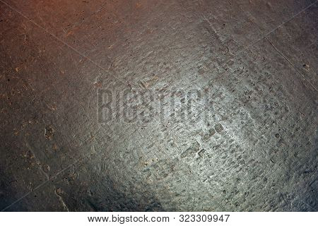 Gray-reddish-colored Stone Background Or Texture; Surface Of The Gray-reddish Stone Wall For Use As