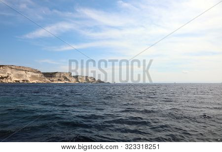 High Cliffs Of The Island Of Corsica And The Mediterranean Sea Near The City Of Bonifacio On A Warm