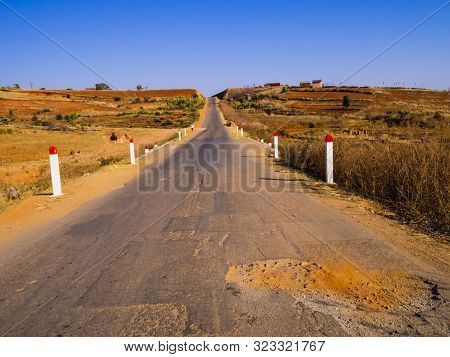 Panoramic Paved Road With Dusty Potholes Leading To Morondava, Madagascar