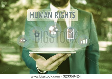 Handwriting text Huanalysis Rights. Concept meaning Moral Principles Standards Norms of a showing protected by Law Male human wear formal work suit presenting presentation using smart device. poster
